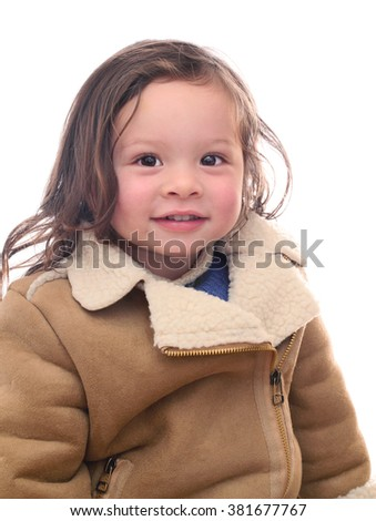 Pretty Young Girl Smiling Wearing a Coat  - stock photo