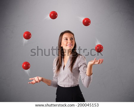 pretty young girl standing and juggling with red balls - stock photo