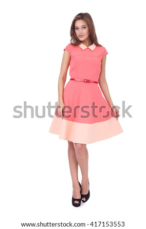 pretty young girl wearing a pink dress - stock photo