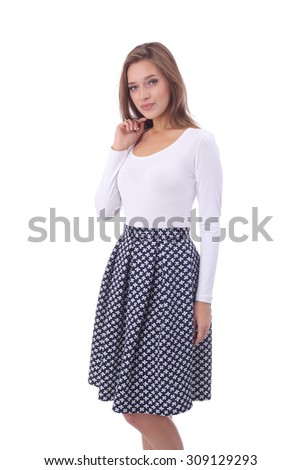 pretty young girl wearing black and white skirt - stock photo