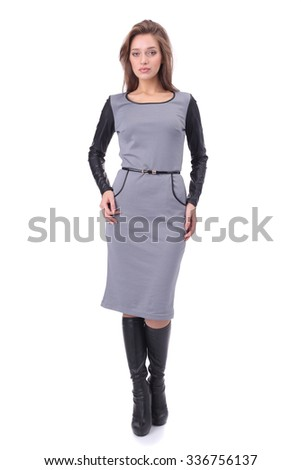 pretty young girl wearing grey dress with the high boots - stock photo