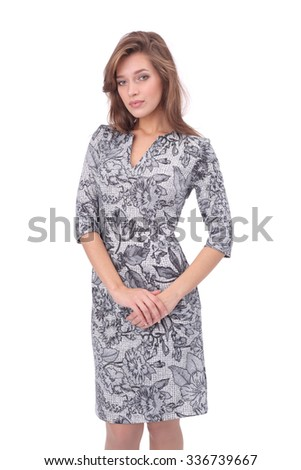 pretty young girl wearing grey printed dress - stock photo