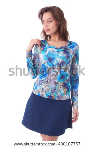 pretty young girl wearing jeans skirt and flower print top - stock photo