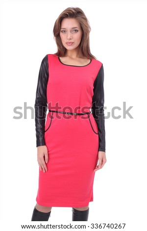 pretty young girl wearing red dress with the high boots - stock photo