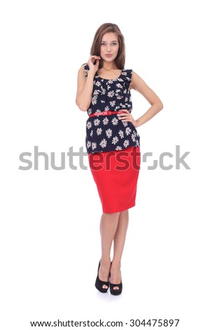 pretty young girl wearing red skirt and floral printed top - stock photo