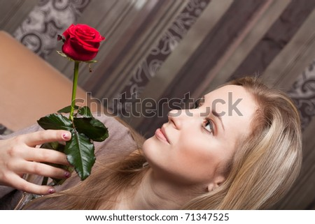 Pretty young girl with a flower - stock photo