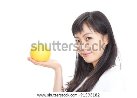 Pretty young girl with grapefruit isolated on white background - stock photo