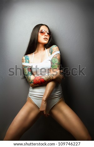 pretty young girl with tattoo. lovely woman. - stock photo
