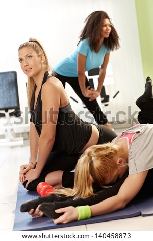 Pretty young girls exercising in health club. - stock photo