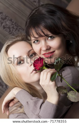 Pretty young girls with a red rose - stock photo