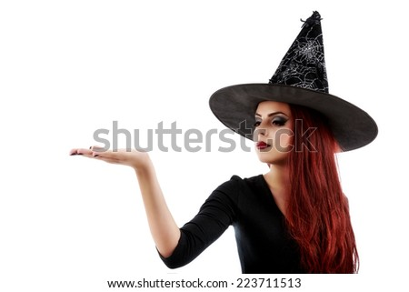 pretty young happy woman smiling and dressed as a fairy or witch for halloween party show open palm with copyspace - stock photo