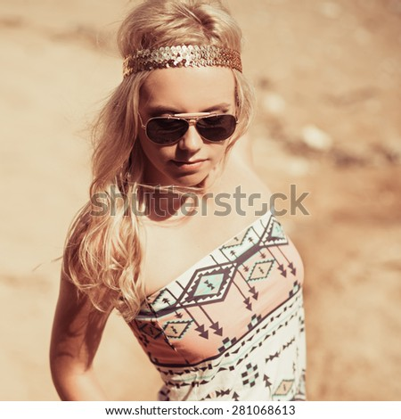 Pretty young hippie caucasian girl, enjoys good weather and the hot sun on a beach. hipster style.  - stock photo