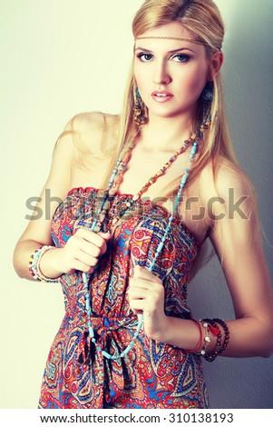 Pretty young hippie caucasian girl in motley boho fashion style outfit Fashion retro toning. - stock photo