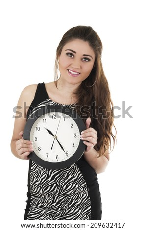 Pretty young hispanic happy girl holding black round clock isolated on white time concept - stock photo