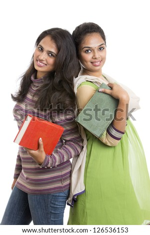 Pretty young Indian girls students posing with books on white. - stock photo
