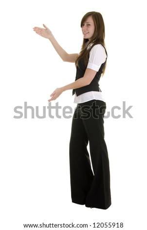 Pretty young lady in black and white business attire isolated on white background, indicating to the left. - stock photo