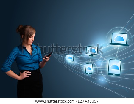 Pretty young lady typing on smartphone with cloud computing - stock photo