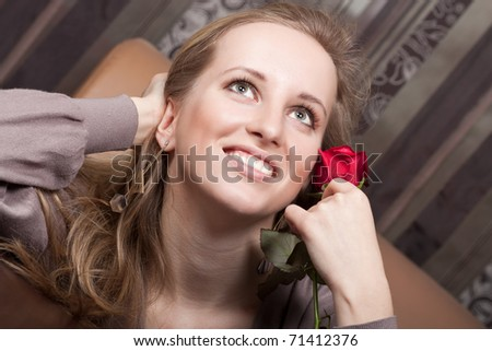 Pretty young lady with a flower - stock photo