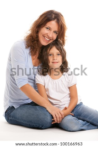 Pretty young mother and daughter - stock photo