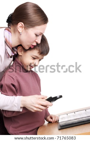 pretty young mother teaching her child to use the magnifying glass - stock photo