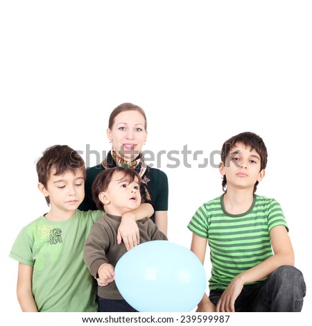 pretty young mother with her three sons - stock photo