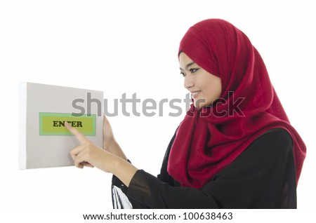 Pretty young Muslim business woman push enter button on white board. - stock photo
