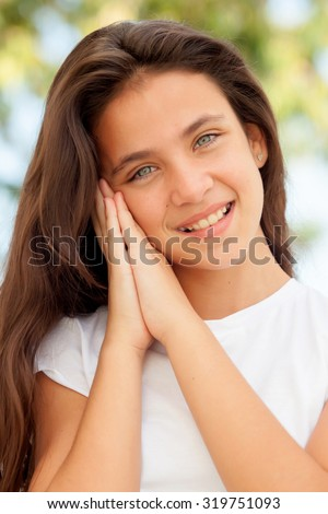 Pretty young preteen making the symbol of sleep outdoors - stock photo