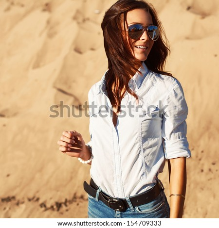 Pretty young sensual woman having fun outdoor in summer.  - stock photo