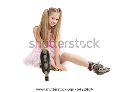 pretty young sweet girl with roller skates - stock photo
