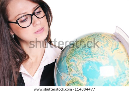 Pretty young teacher with globe over white background - stock photo