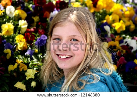 Pretty young teen girl with flower background - stock photo