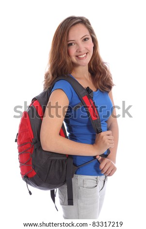 Pretty young teenager school girl 16, with long brown hair wearing blue t shirt and red school backpack with big happy smile. Studio shot against white background. - stock photo