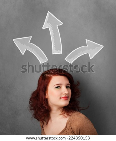 Pretty young woman deciding with sketched arrows above her head - stock photo