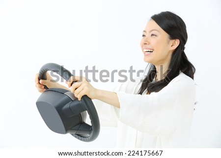 Pretty young woman driving a car. - stock photo