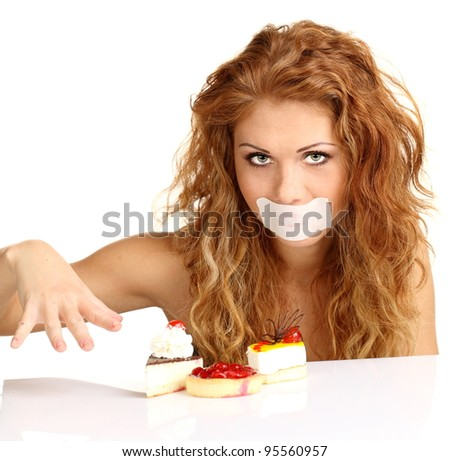 Pretty young woman eating cake. Isolated on the white background - stock photo