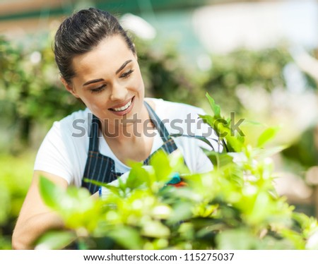 pretty young woman gardening - stock photo