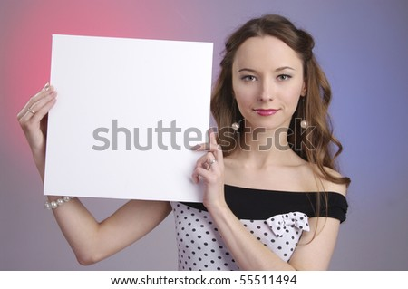 Pretty young woman holding a blank sign board - stock photo