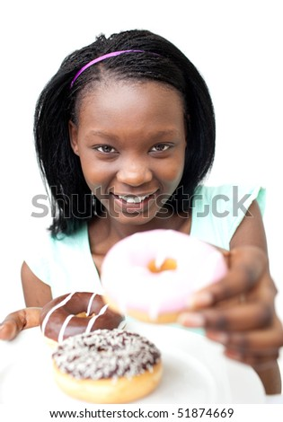 Pretty young woman holding a donut against a white background - stock photo