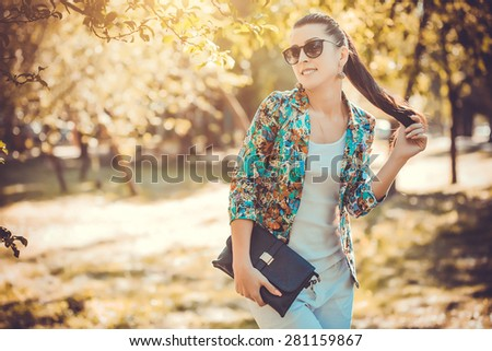 pretty young woman in a summer park - stock photo