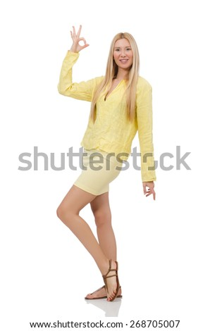 Pretty young woman in summer yellow clothing isolated on white - stock photo