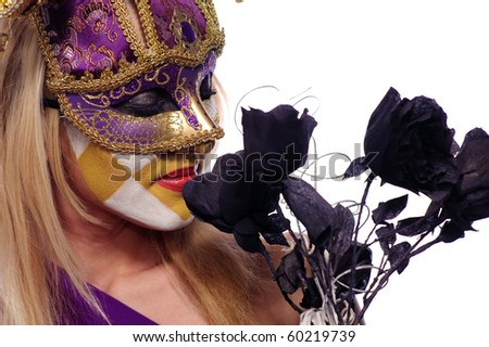 pretty young woman in violet mask sniff black roses, isolated on white, may be use for Venice concept - stock photo
