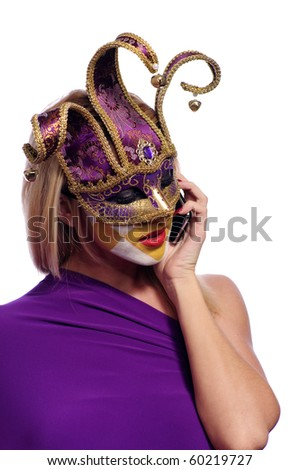 pretty young woman in violet mask speak on the phone, isolated on white - stock photo