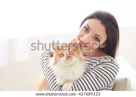 Pretty young woman is resting with animal - stock photo
