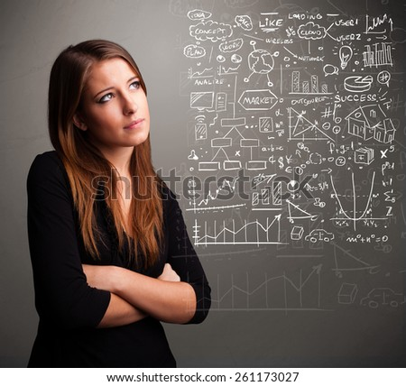 Pretty young woman looking at stock market graphs and symbols - stock photo