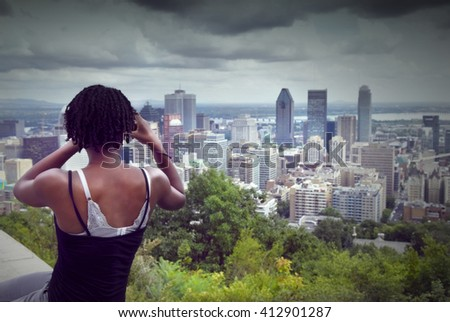 pretty young woman looks at Montreal, Quebec, Canada - stock photo
