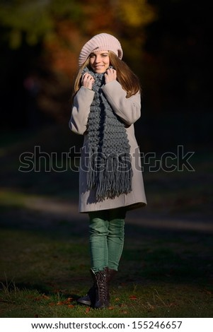 pretty young woman outdoor in autumn - stock photo