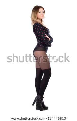 Pretty young woman posing in black tights and shoes. Isolated on white - stock photo