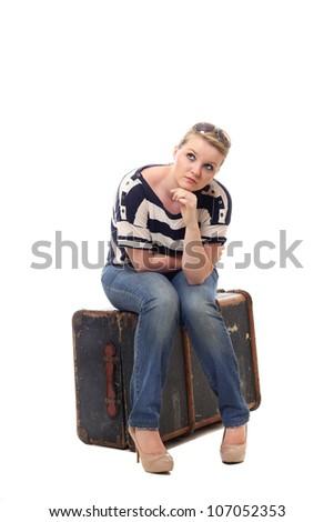 Pretty young woman preparing to travel alone - stock photo