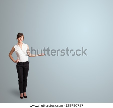 Pretty young woman presenting copy space - stock photo