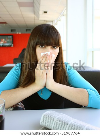 Pretty young woman reading newspaper - stock photo